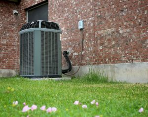 Outside Air Conditioning Unit on Grass