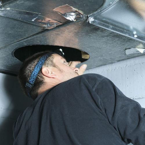 Furnace repair by an HVAC technician